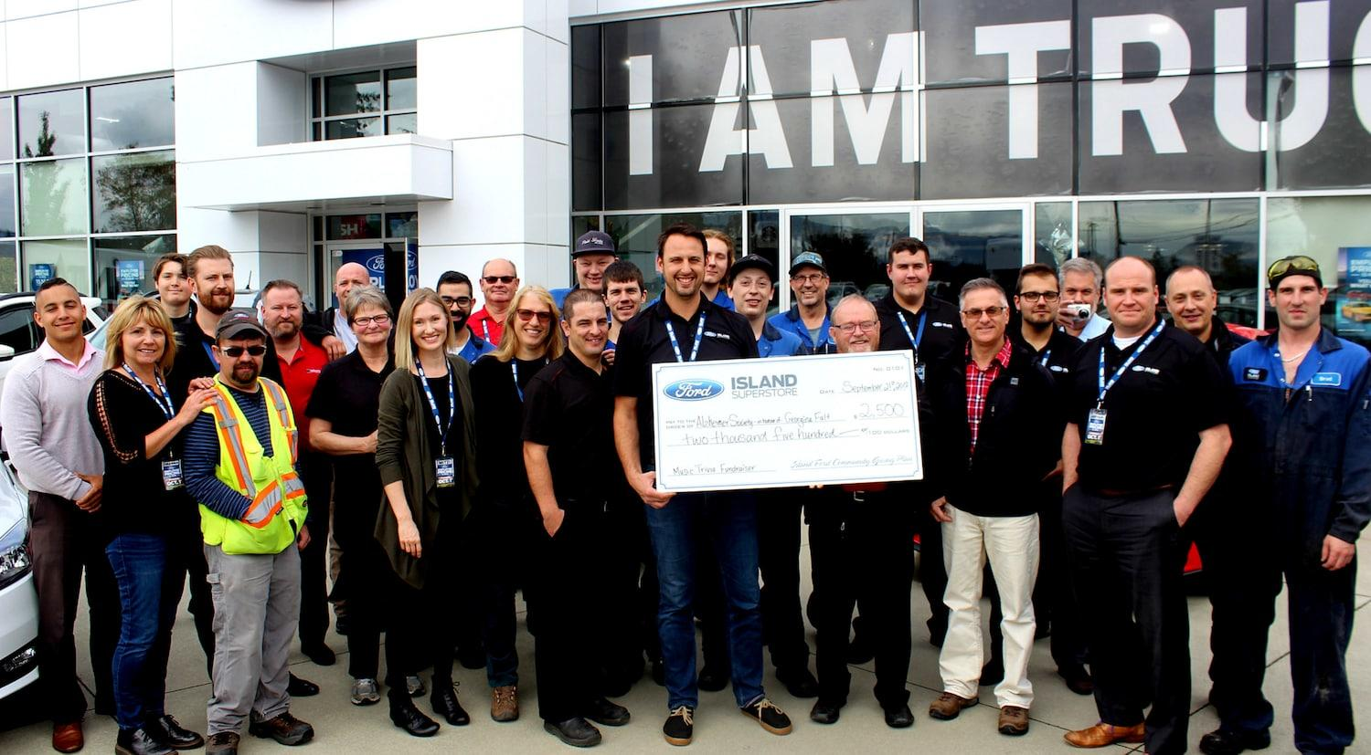 Island Ford donating to the Alzheimer's society Georgina Fault Music Trivia fundraiser